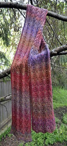 Nothern Pines Lace Scarf by Judith Brodnicki makes the most of a self-striping yarn to wrap you in lacy waves of beautiful colour.  Knit one in our elann.com Meander available from Amazon.  http://international.elann.com