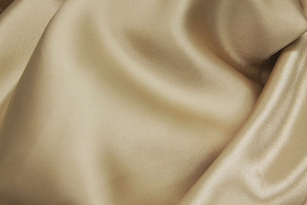 7f7616af25489 Good prices on linens and bolts of fabric like this: 40 yds Satin Fabric  Roll - Champagne for $60