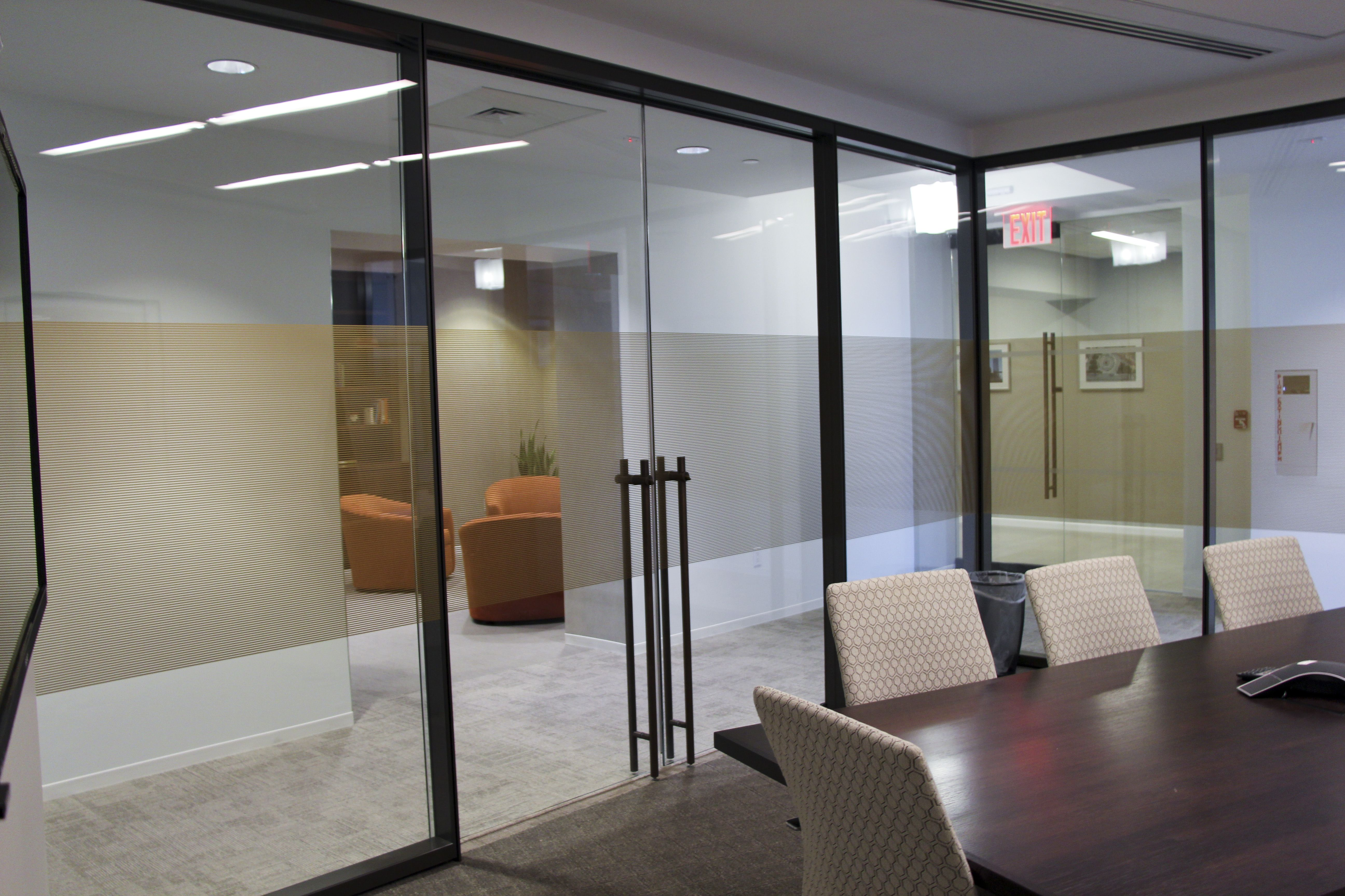 Refine double glazed walls with frameless double sliding for Sliding glass wall systems