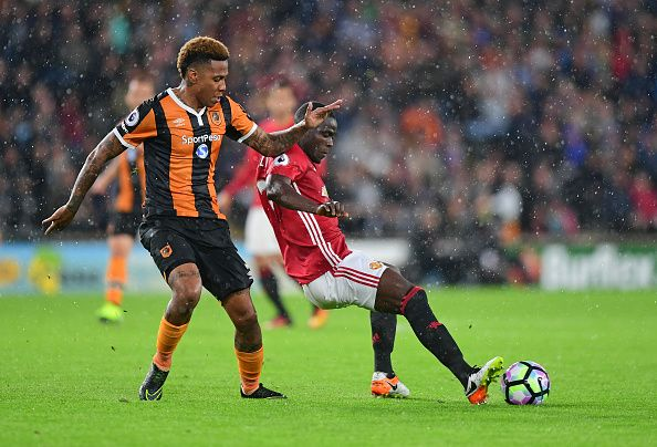 Hull City's Abel Hernandez Is Tackled By Manchester United