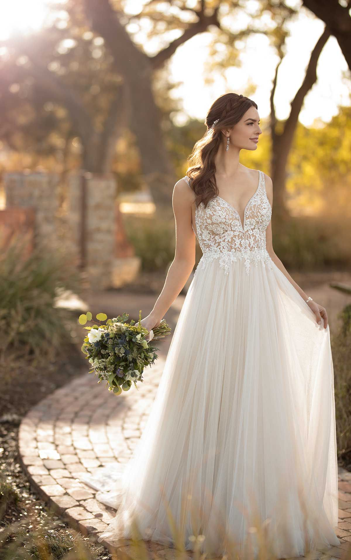 Soft tulle aline wedding dress with a deep vneckline and sheer
