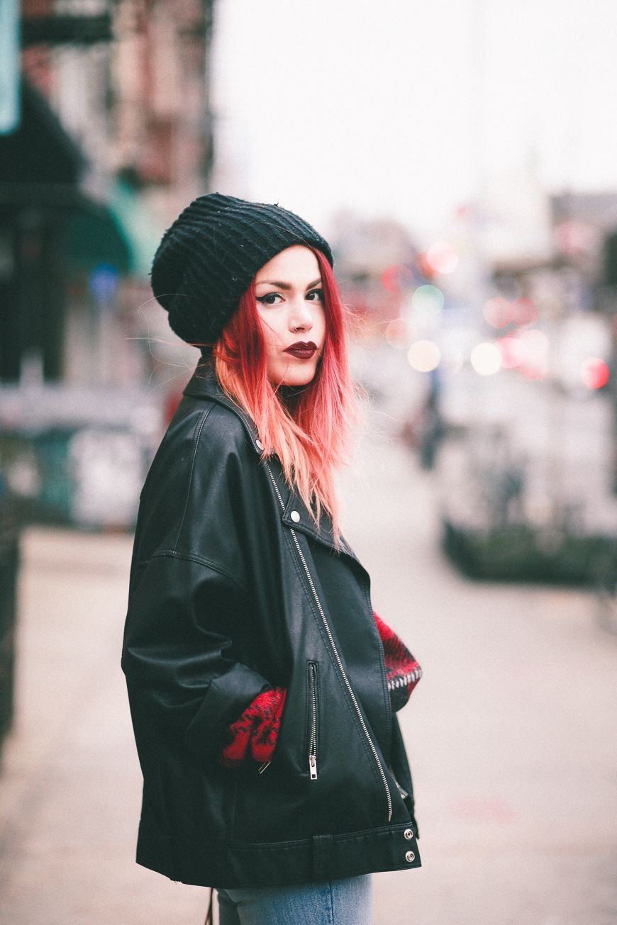 female punk wearing a beanie