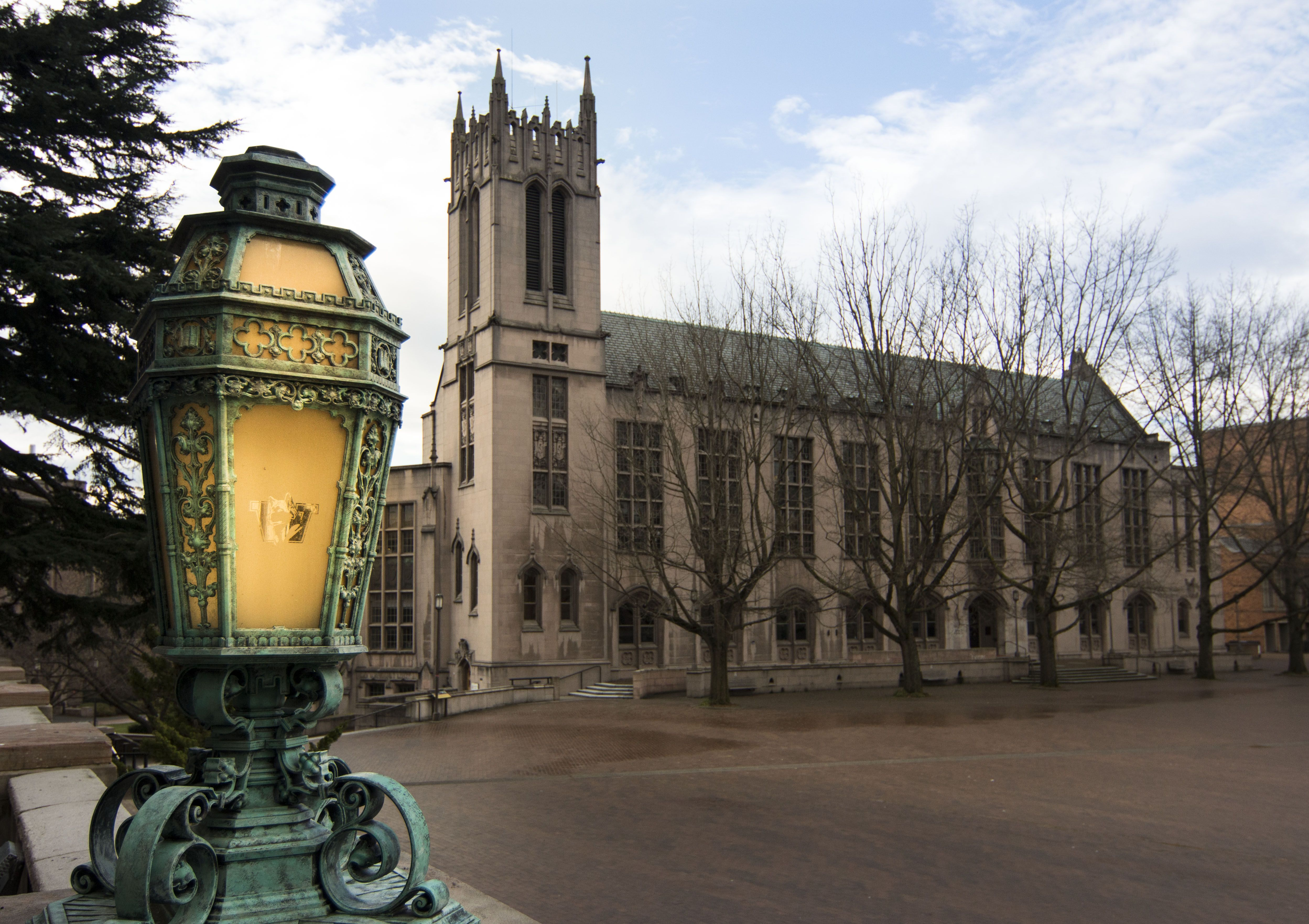 Suzzallo Library lamp with Gerberding Hall in the background.