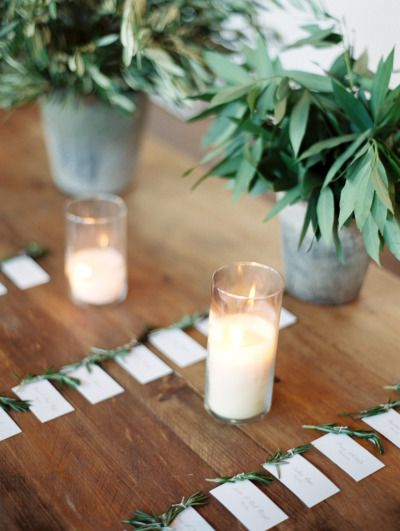 Escort cards with rosemary: http://www.stylemepretty.com/little-black-book-blog/2015/04/23/industrial-italian-chicago-wedding/ | Photography: Clary Pfeiffer - http://www.claryphoto.com/