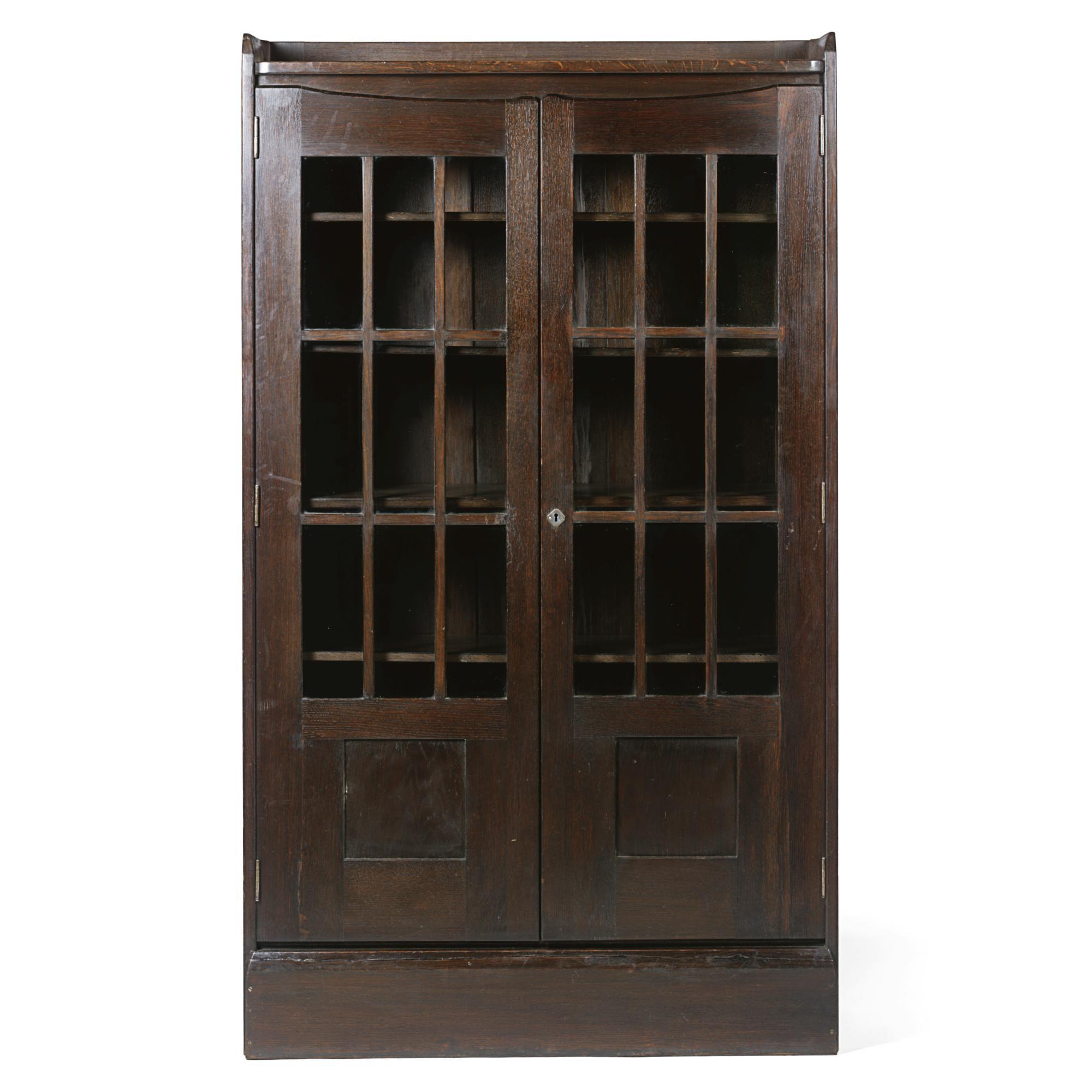 Richard Riemerschmid A Bookcase With Three Quarter Rear Gallery Above Glazed Cupboard Doors Enclosing Five Adjule Shelves High By Wide Deep