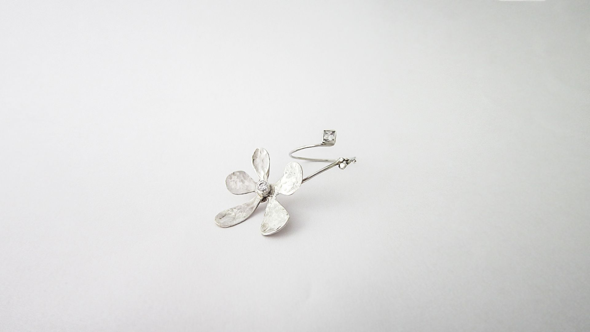 Sparkling cherry flower- Ikebana, Elena Crisan's jewellery collection; the ring is made of silver and two zicorn stones.