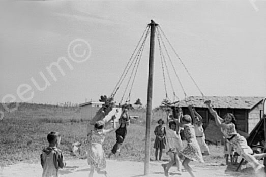 Maypole  I never saw one until I moved to Woodsfield and there was one on the school playground! The first day of school I tried it and got punched by another girl b/c I didn't swing fast enough! geesssshhh