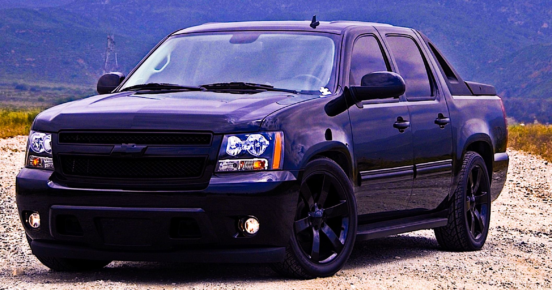 Customized chevrolet avalanche back on black baby