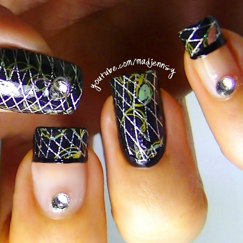 This creative manicure experiments with nail foil application and rhinestones for a blinged out nail art look.