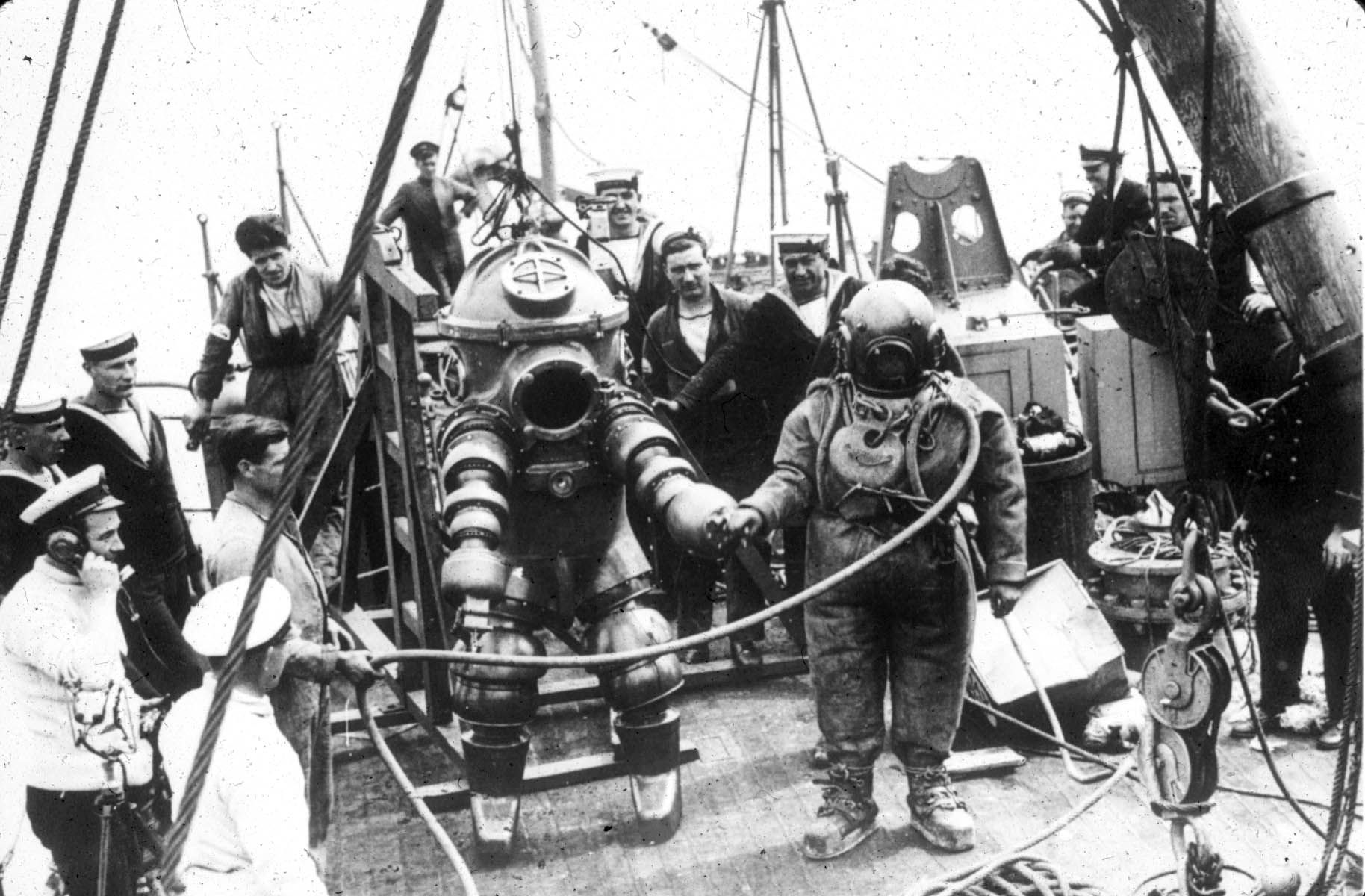 Rms lusitania wreck rms lusitania wreck quotes - Two Divers One Wearing A 1 Atmosphere Diving Suit And The Other Standard Diving Dress Preparing To Explore The Wreck Of The Rms Lusitania 1935