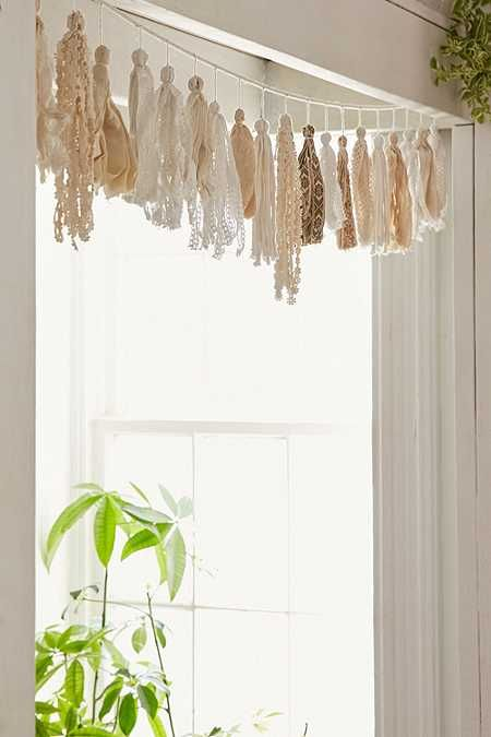 This looks like it could be a cool DIY project.............Plum & Bow Tassel Garland Banner