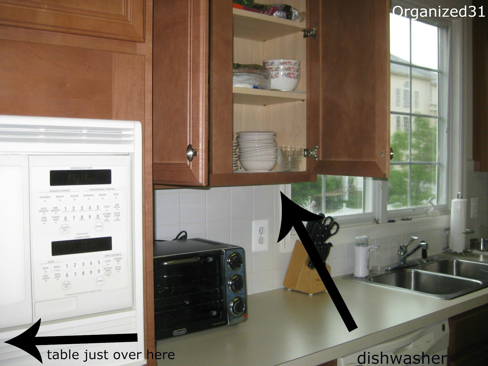 Tips on how to set up your kitchen if youre moving into a new home from a mom that has moved into and organized over 20 homes and kitchens