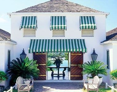 Wood Shingle Roof Striped Awnings Doors With Brass Accents Lanterns