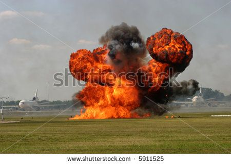 Airshow Demolition Explosion Demonstration on Runway showing fire and smoke - stock photo