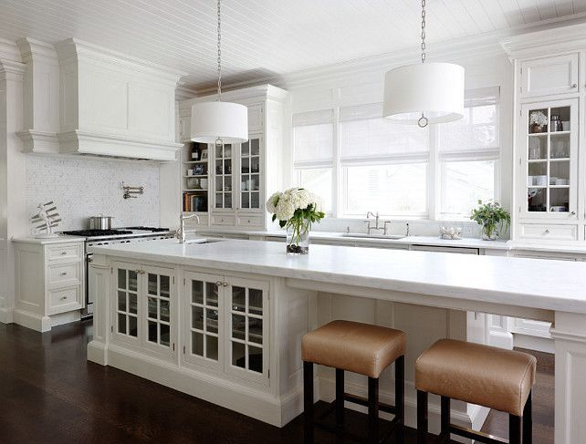 Long kitchen island. If I had lots of money to redo our kitchen, this would be the layout! #longnarrowkitchen