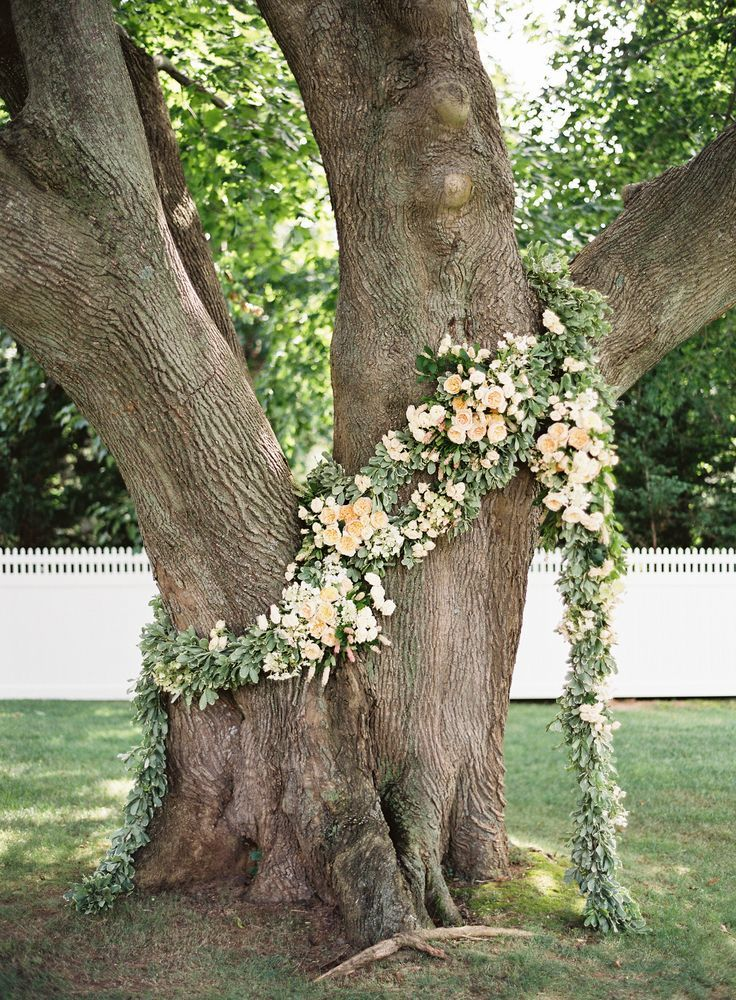 Flower Garland Wrapped Around Tree Trunk Tree Wedding Ceremony Wedding Ceremony Flowers Ceremony Flowers