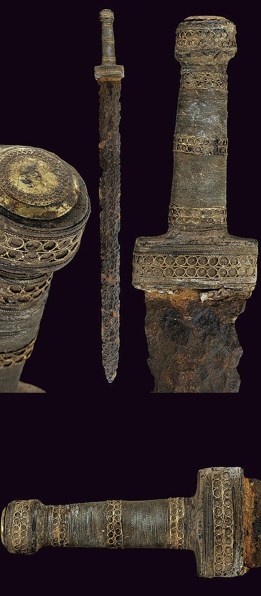 Sword from the Merovingian period (428-752 AD). The shape of the hilt seems to belong to the transition period between the 2nd type (northern swords with decorated, silver hilt dated around 300 AD, found in Kragehul Mose, Denmark)