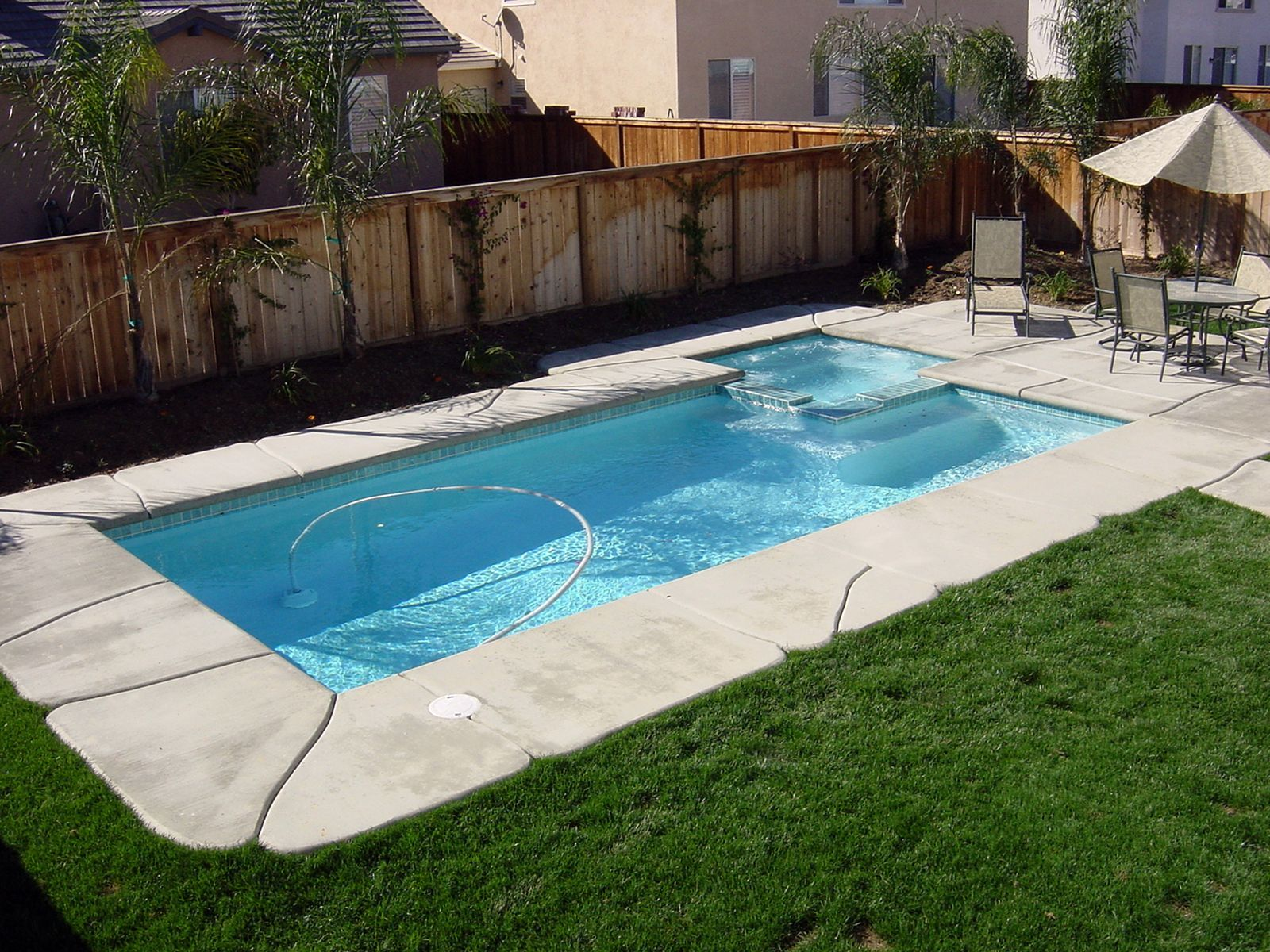 8 Amazing Small Swimming Pool For Summer Preparation Simple Pool Pool Landscaping Pool Designs