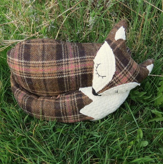 A large snoozy fox cushion in tartan wool. 39cm in length. £25.00