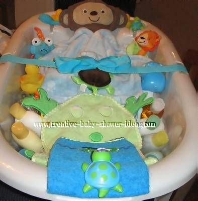 baby bath centerpiece baby shower gift a baby tub an assortment of bath products lotions. Black Bedroom Furniture Sets. Home Design Ideas
