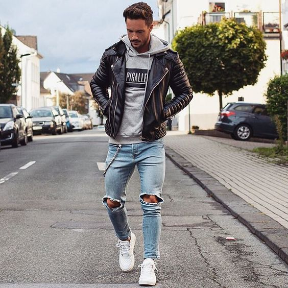 f2d8f286835 This on-trend ensemble is easy to break down  a black leather biker jacket  and light blue ripped jeans. Add a pair of white leather low top sneakers  to this ...
