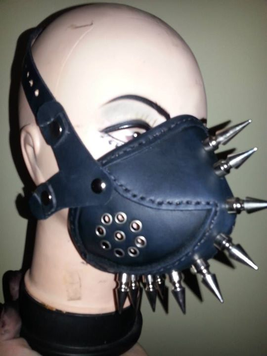 Custom made leather respirator with spikes hand made by Steam Generation   Made using 2.5mm and 3mm veg tan leather, silver rivets / buckles / spikes, hand dyed and stitched