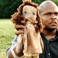 T Dog points out that Daryl found Sophia's doll during his search