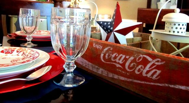 vintage coke crate repurposed as a tray for condiment service, window valances as table runners