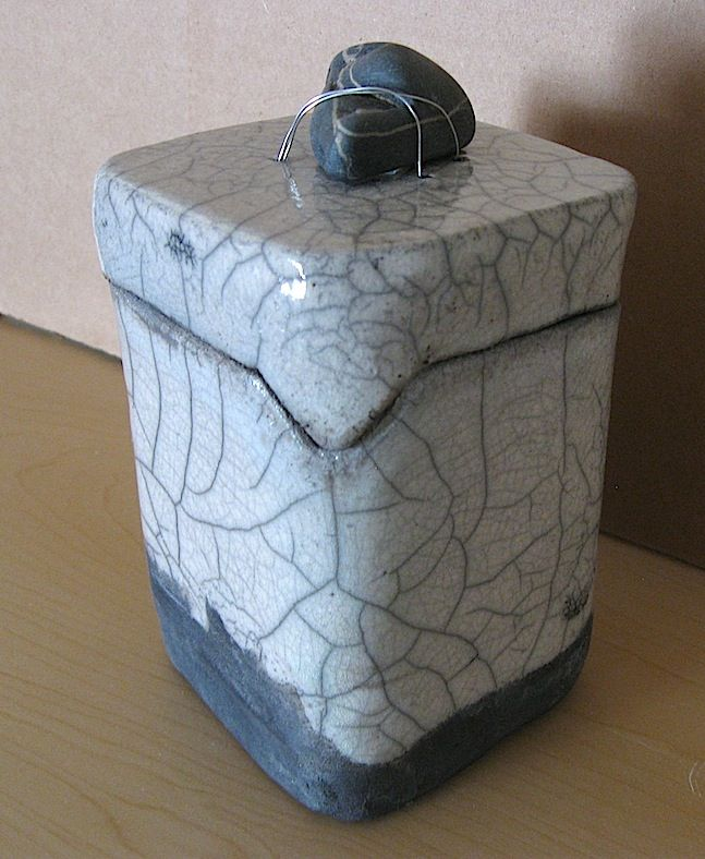 E.Sue McCoy: 6 inch tall square box with stone, raku, white crackle glaze