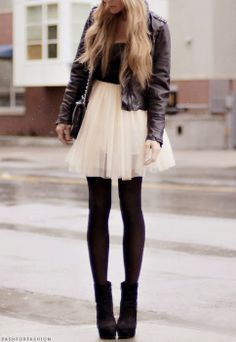 Black crop top, tutu skirt, leather jacket, ankle boots. casual chic.