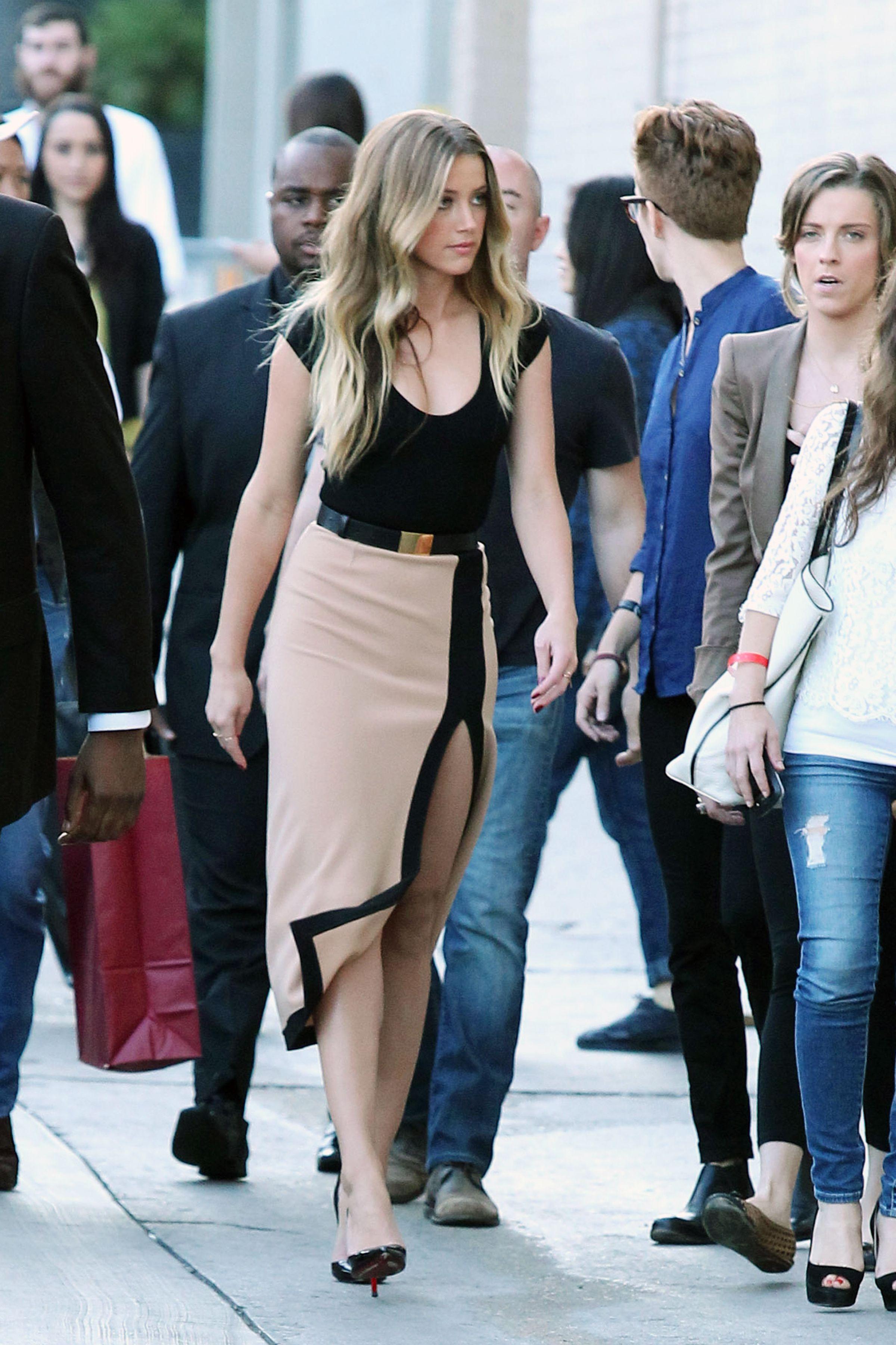 Amber Heard Photos Photos - Amber Heard Shows Some Leg on