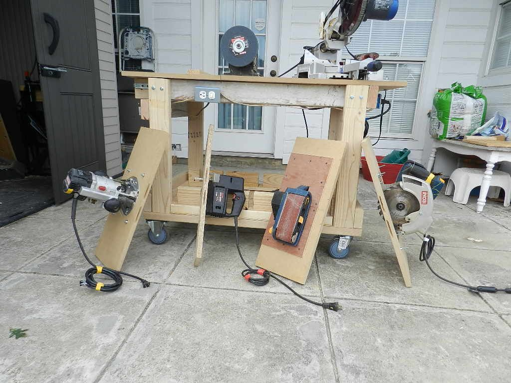 Rolling workbench with seven power tools and fits into a 7