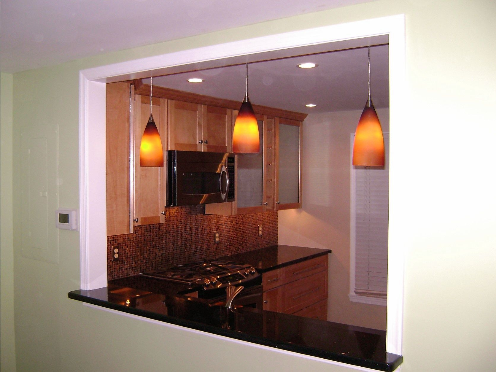 Pendant Lights In A Newly Created Opening Between The Kitchen And
