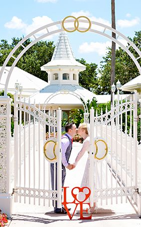 "Cute kisses after saying ""I do at Disney's Wedding Pavilion"