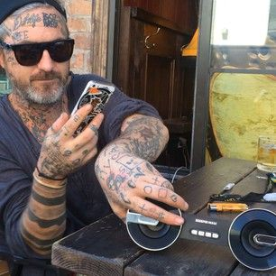 Nate Bozung tattoos - This guy is such a looser! And he USE