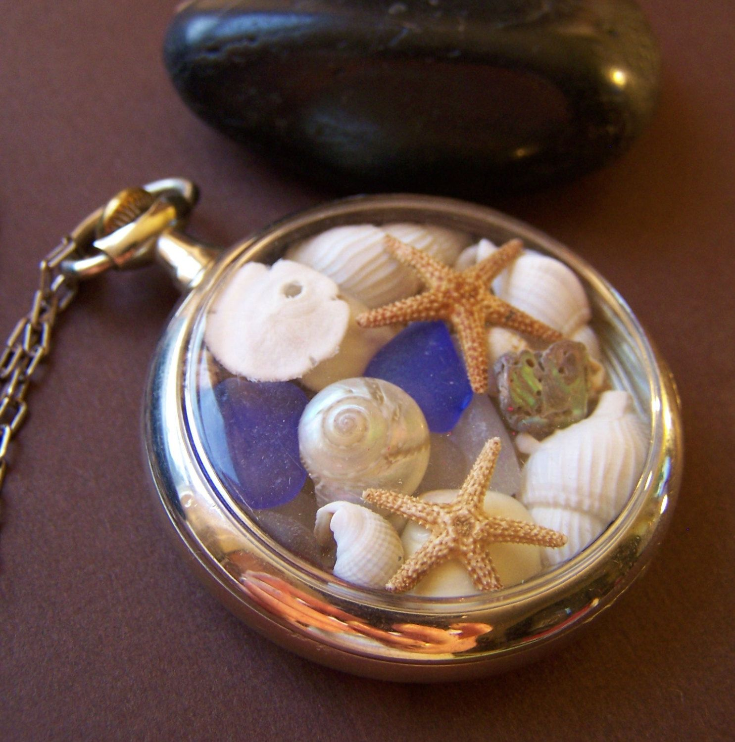 Wallis Sands Ocean Locket - Vintage Pocket Watch Case with Sea Glass Treasures. $139.00, via Etsy.