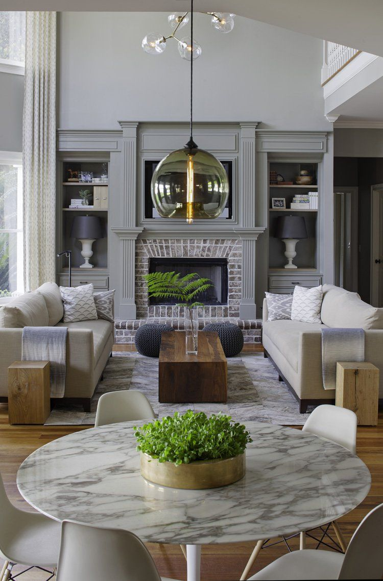 transitional style living room blue couch decor a family home gets makeover that s ultra stylish