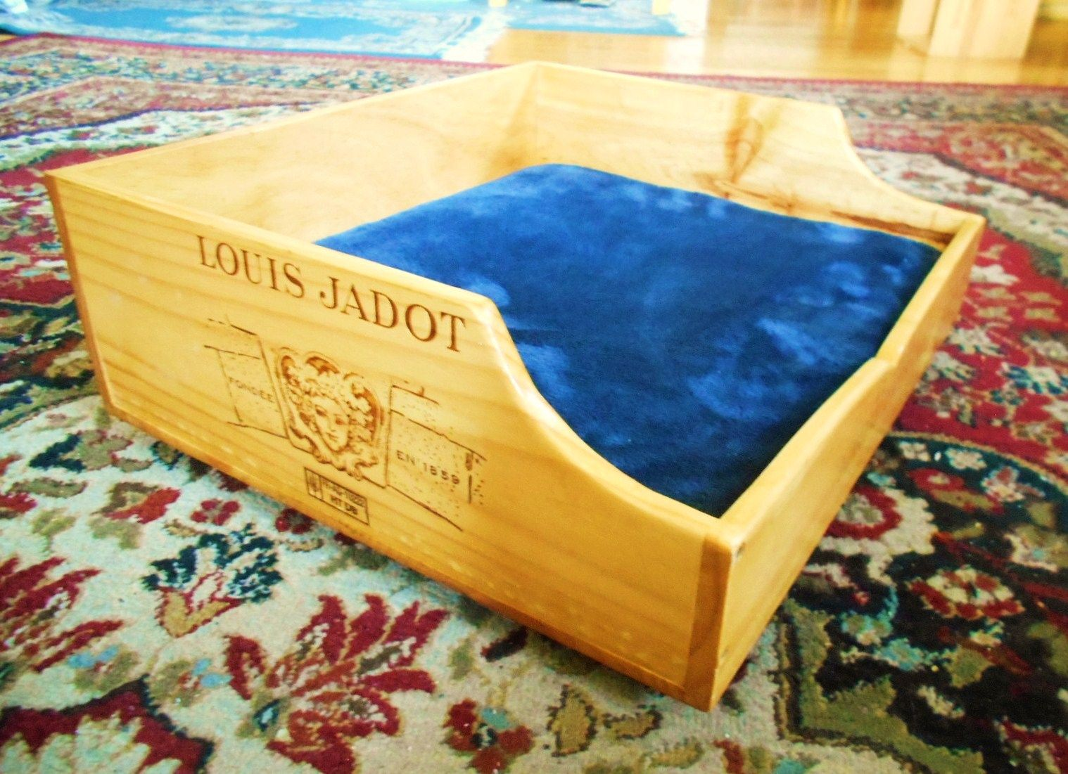 Pet bed designed from a french brand wine box with a soft padding