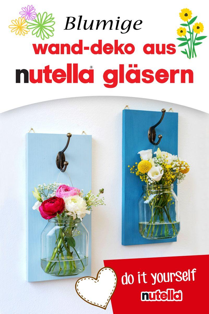 Blumige Wanddeko aus nutella Gläsern #gartenupcycling