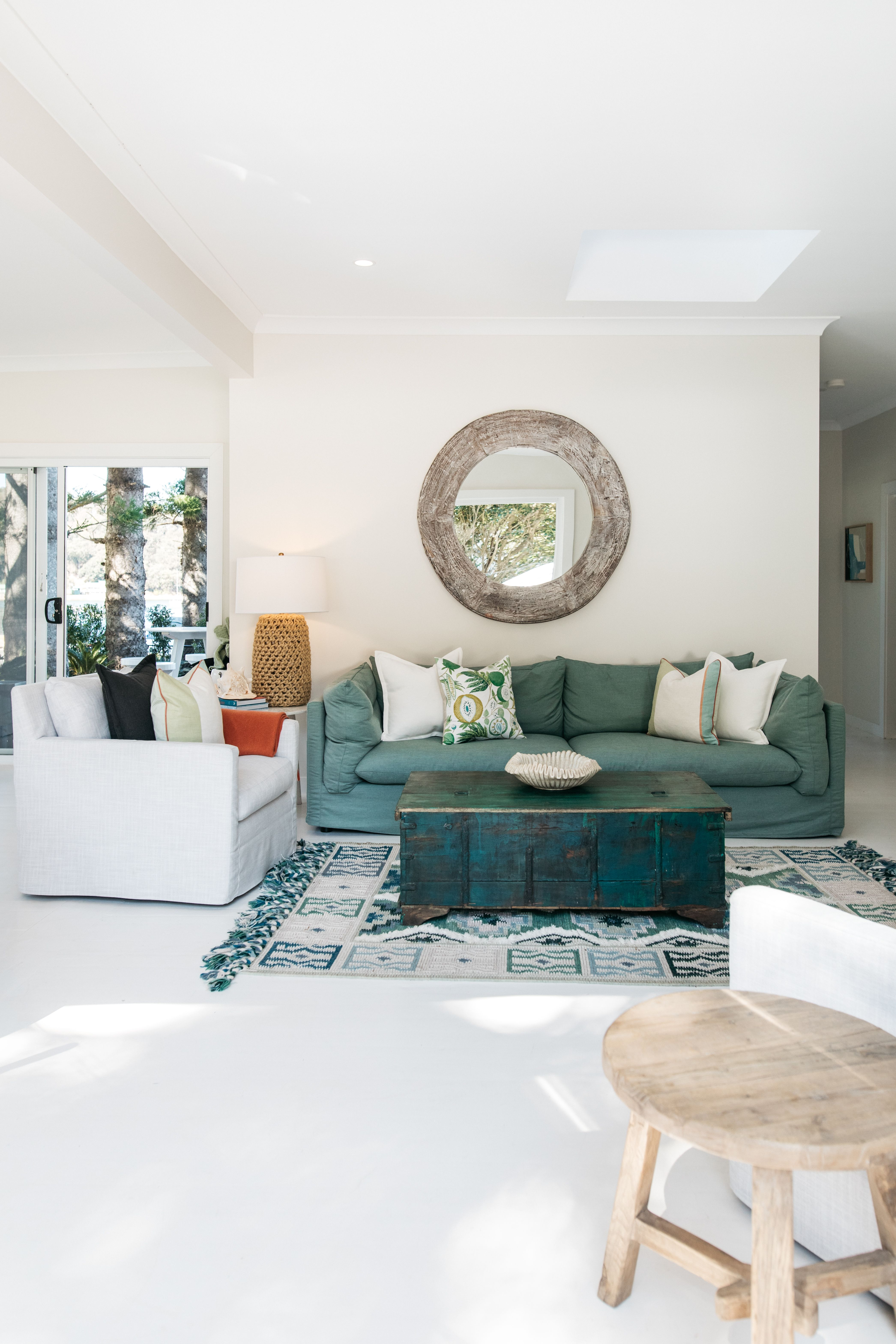The living room interiors of The Patonga Cottage on the New South Wales Central Coast. All interiors sourced from the team at The Boathouse Home. #cushion #boathouse #hotel #interiors #livingroom #styling #livingroomdesigns #travel #newsouthwales
