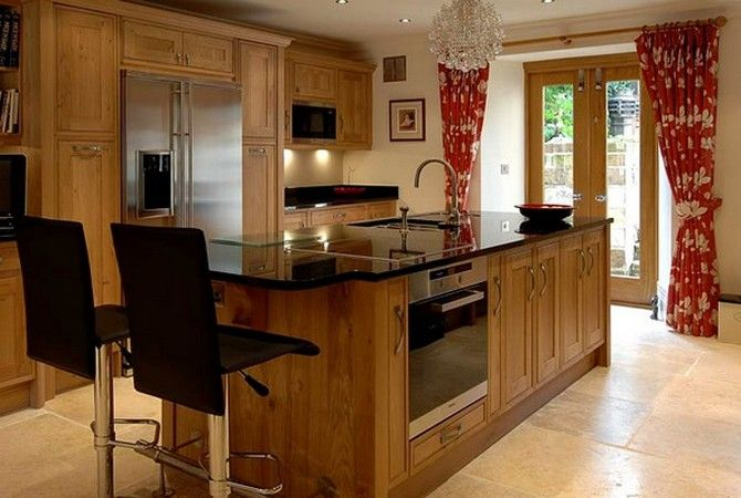 A transitional straight line kitchen with maple cabinets ...