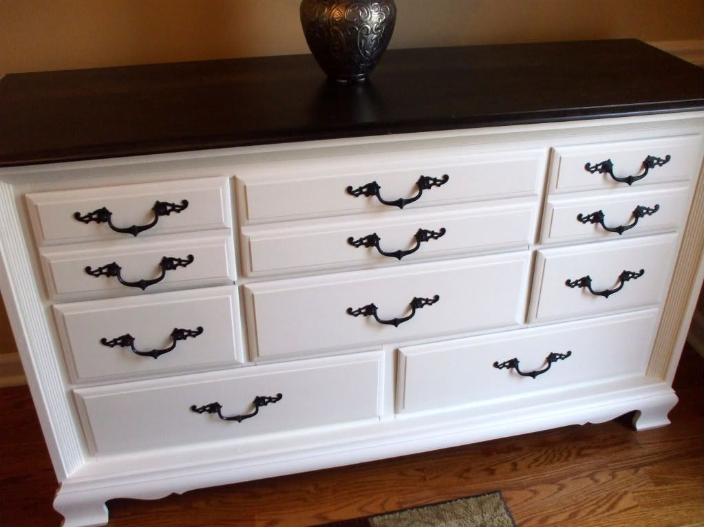 Repainted Furniture stripped the top and then stained it with ebony stain painted the