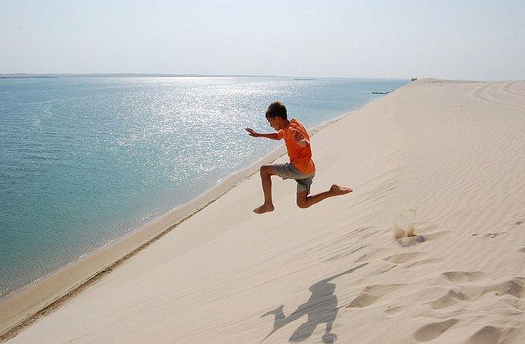 Khor Al Udaid Located South Of Doha The Sand Dunes Embrace Sea Surrounded By Many Sabkha Deposits
