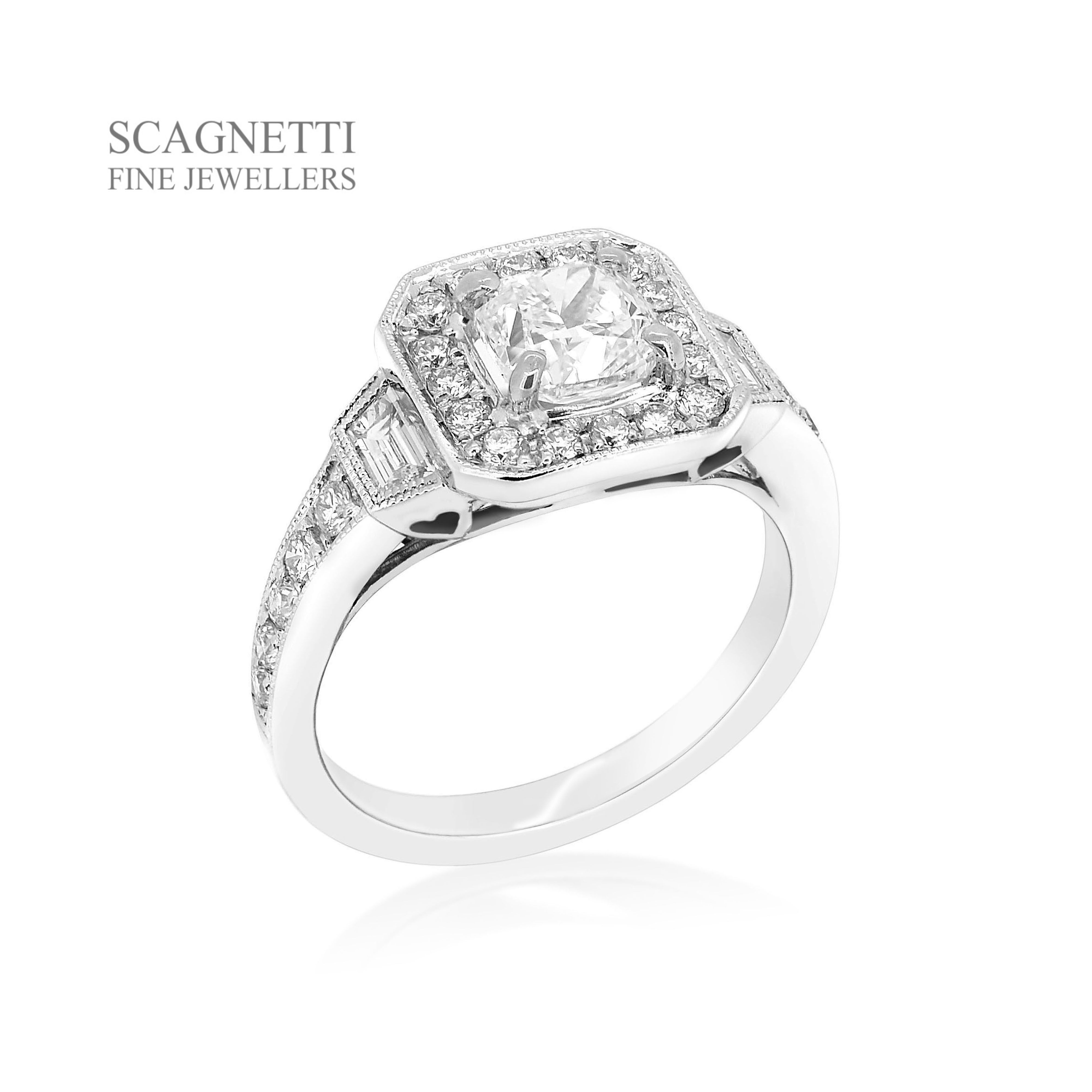 This ring features a beautiful cushion cut diamond shown off by a