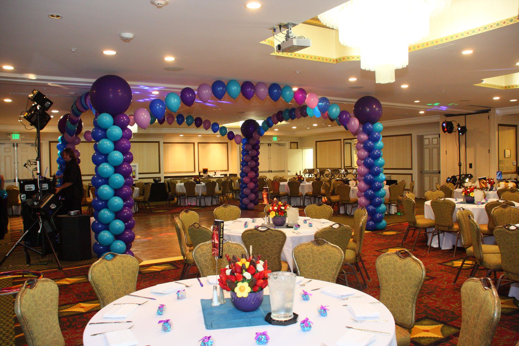 Festive balloon arch surrounding the dance floor at the Hilton ...