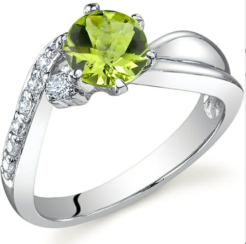 'Genuine Peridot .925 Sterling Silver Ring Size 5 to9' is going up for auction at  2pm Tue, Jul 3 with a starting bid of $1.