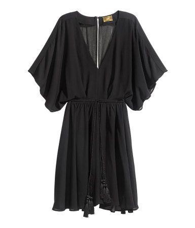 Zwarte jurk wijde mouwen