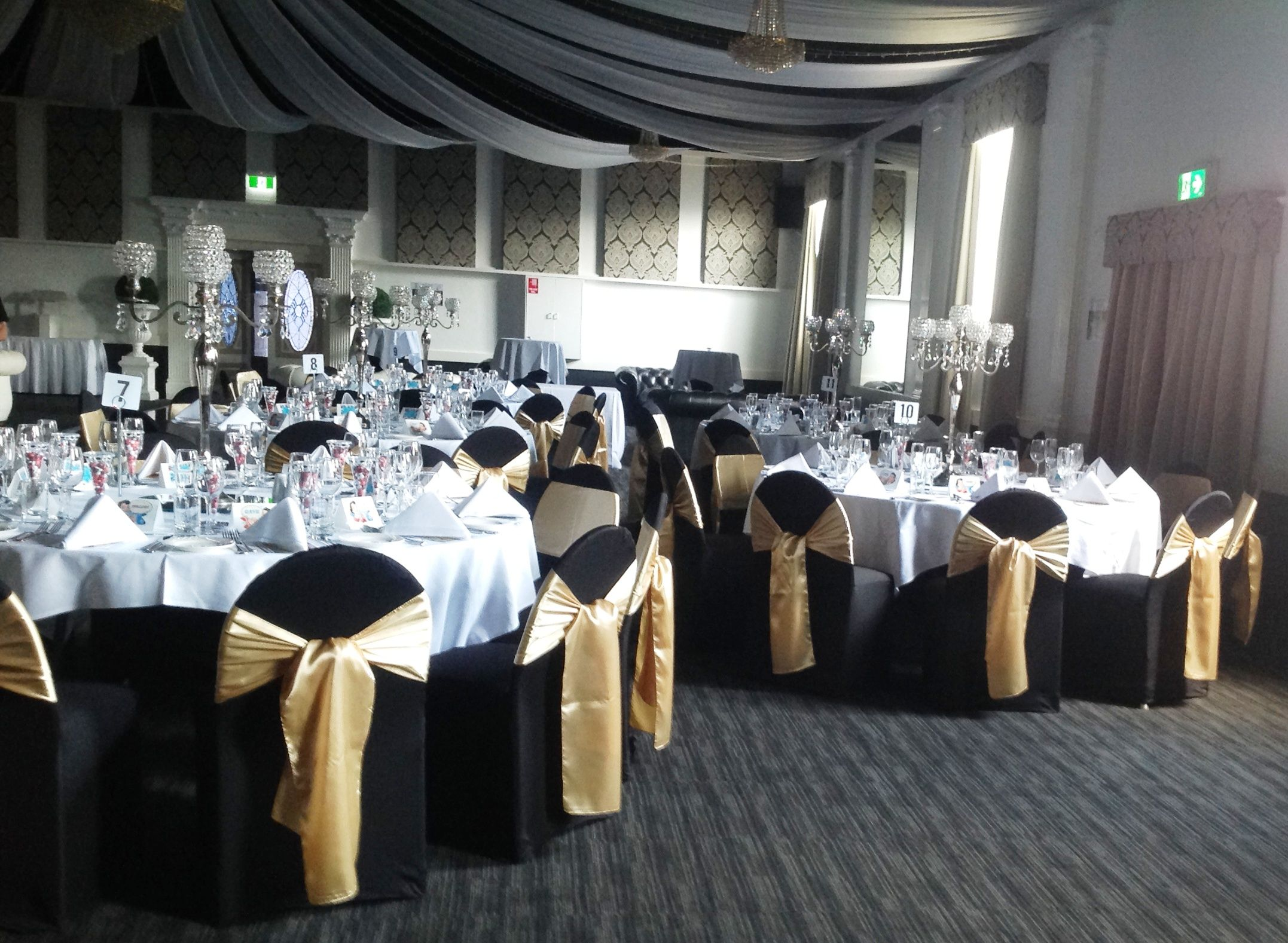 Black chair covers with gold satin sash and glass candelabra black chair covers with gold satin sash and glass candelabra centrepieces for adelaide wedding reception decor junglespirit Image collections