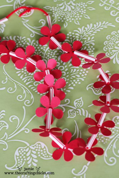 Make your own leis for a party with paper-punch flowers and straws. #Hawaii #Party #Luau