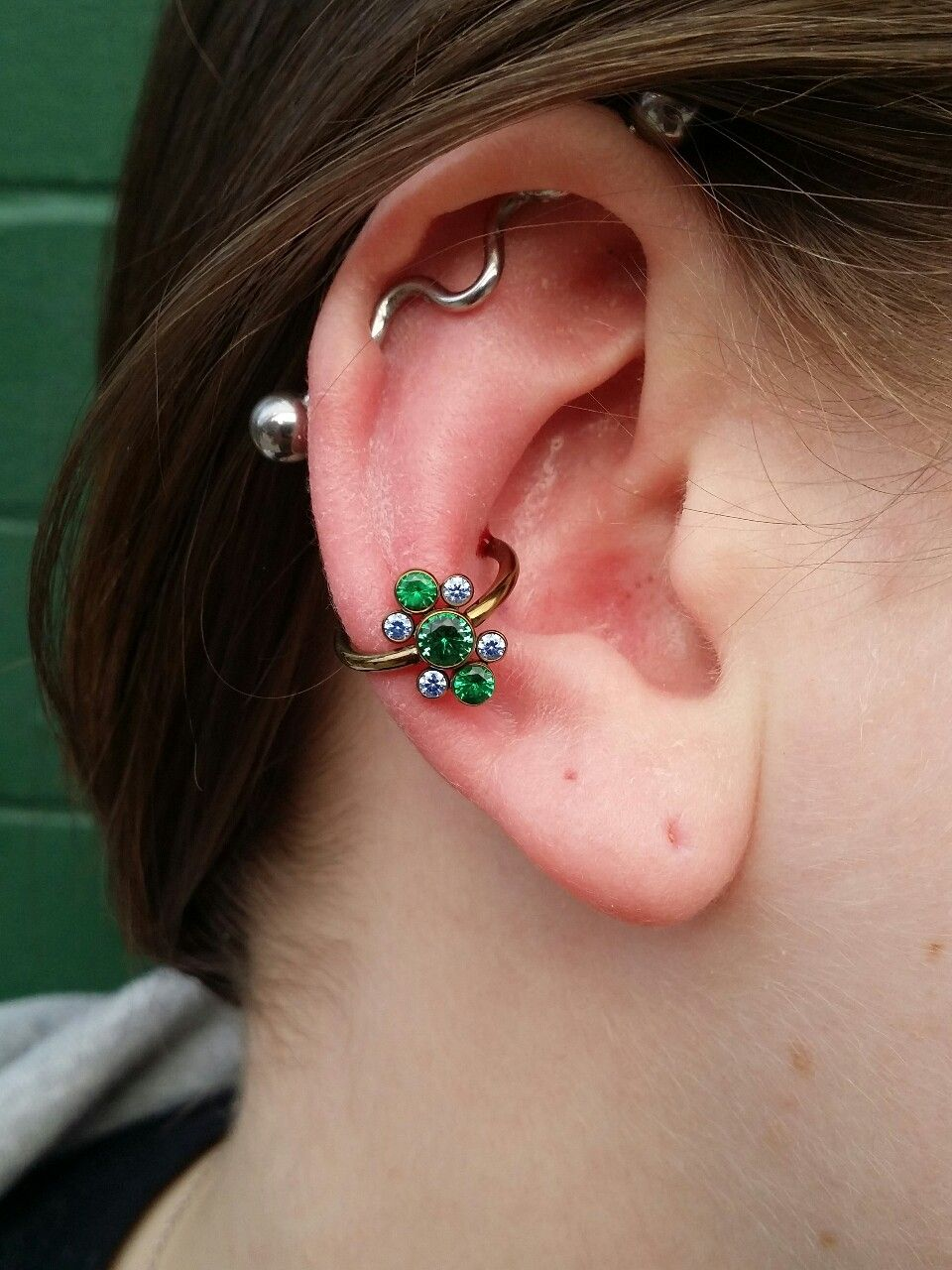 What is body piercing  Conch piercing performed with all titanium jewelry from anatometal